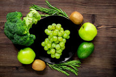 Healthy green food with fresh vegetables on wooden table background top view. Healthy green food with fresh vegetables on wooden kitchen table background top Stock Photo