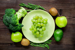Healthy green food with fresh vegetables on wooden table background top view. Healthy green food with fresh vegetables on wooden kitchen table background top Royalty Free Stock Images