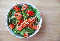 Healthy green leaves paprika pine nuts salad Stock Image