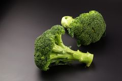 Healthy Green Organic Raw Broccoli Florets Ready for Cooking.  Royalty Free Stock Photography
