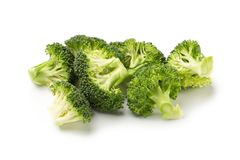 Healthy Green Organic Raw Broccoli Florets Ready for Cooking.  Stock Photo