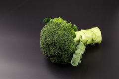 Healthy Green Organic Raw Broccoli Florets Ready for Cooking.  Royalty Free Stock Photos