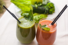 Healthy green and red smoothies and ingredients - superfoods, detox, diet, health, vegetarian food concept Royalty Free Stock Image