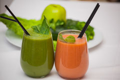 Healthy green and red smoothies and ingredients - superfoods, detox, diet, health, vegetarian food concept.  Stock Images