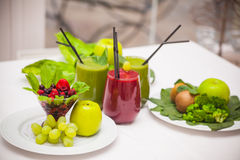 Healthy green and red smoothies and ingredients - superfoods, detox, diet, health, vegetarian food concept. Royalty Free Stock Photography