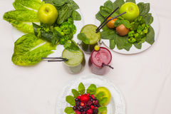 Healthy green and red smoothies and ingredients - superfoods, detox, diet, health, vegetarian food concept. Royalty Free Stock Image