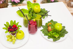 Healthy green and red smoothies and ingredients - superfoods, detox, diet, health, vegetarian food concept. Royalty Free Stock Images