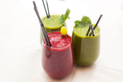 Healthy green and red smoothies - superfoods, detox, diet, health, vegetarian food concept. Royalty Free Stock Photos