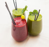 Healthy green and red smoothies - superfoods, detox, diet, health, vegetarian food concept. Stock Photos