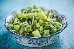 Healthy green salad. From above on blue vibrant table Stock Photo