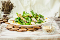 Healthy green salad with avocado, mangold leaves and crispy crac Royalty Free Stock Images