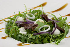 Healthy green salad with dressing Royalty Free Stock Photography