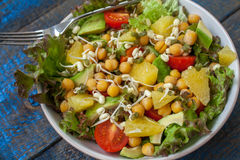 Healthy green salad with orange, avocado, tomatoes Royalty Free Stock Photos