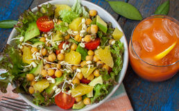 Healthy green salad with orange, avocado, tomatoes Royalty Free Stock Images