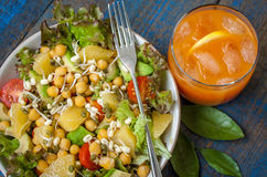 Healthy green salad with orange, avocado, tomatoes, sprouts of mung bean Royalty Free Stock Images