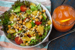 Healthy green salad with orange, avocado, tomatoes, sprouts of mung bean Stock Photo