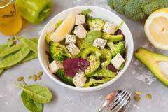 Healthy green salad with tofu, broccoli, avocado, peas and chia. Healthy green salad with broccoli, avocado, peas and chia seeds. Vegan trend food concept Stock Photography
