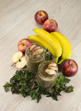 Healthy green smoothie with apples,bananas,nettle and cinnamon. Fully raw food Royalty Free Stock Photography