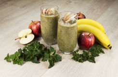 Healthy green smoothie with apples,bananas,nettle and cinnamon. Fully raw food Stock Photography