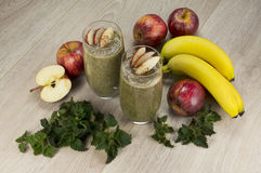 Healthy green smoothie with apples,bananas,nettle and cinnamon. Fully raw food Royalty Free Stock Images
