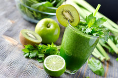 Healthy green smoothie beverage with spinach and celery Royalty Free Stock Photography