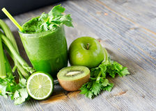 Healthy green smoothie beverage with spinach and celery. Blended smoothie with ingredients selective focus copy space Stock Image