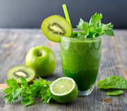 Healthy green smoothie beverage with spinach and celery Royalty Free Stock Photo