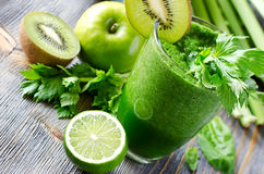 Healthy green smoothie drink with spinach and celery Royalty Free Stock Photo
