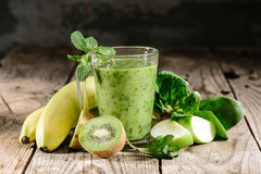 Healthy green smoothie in a glass of spinach Royalty Free Stock Image