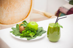 Healthy green smoothie and ingredients - superfoods, detox, diet, health, vegetarian food concept. Stock Image