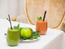 Healthy green smoothie and ingredients - superfoods, detox, diet, health, vegetarian food concept. Royalty Free Stock Images