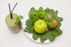 Healthy green smoothie and ingredients - superfoods, detox, diet, health, vegetarian food concept. Royalty Free Stock Photos