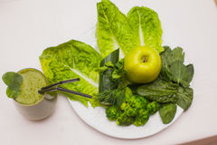Healthy green smoothie and ingredients - superfoods, detox, diet, health, vegetarian food concept. Stock Images