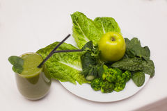 Healthy green smoothie and ingredients - superfoods, detox, diet, health, vegetarian food concept. Stock Photos