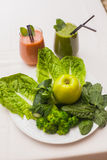 Healthy green smoothie and ingredients - superfoods, detox, diet, health, vegetarian food concept. Royalty Free Stock Photo