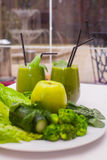Healthy green smoothie and ingredients - superfoods, detox, diet, health, vegetarian food concept. Stock Photo