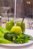 Healthy green smoothie and ingredients - superfoods, detox, diet, health, vegetarian food concept. Stock Photography