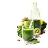 Healthy green smoothie and ingredients Royalty Free Stock Photo