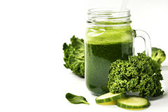 Healthy green smoothie and ingredients Royalty Free Stock Photos