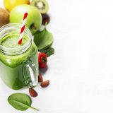Healthy green smoothie and ingredients Stock Image