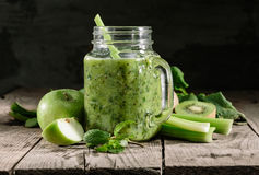 Healthy green smoothie in a jar mug Royalty Free Stock Images