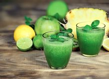 Healthy green smoothie, refreshing and healthy drink. Green smoothie made with fresh organic fruit Stock Photo