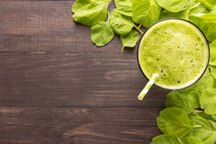 Healthy green smoothie on rustic wood background.  Stock Images