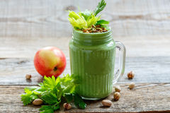 Healthy green smoothie spinach, apple and banana. Royalty Free Stock Photos