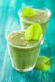 Healthy green smoothie with spinach leaves Royalty Free Stock Image