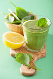 Healthy green smoothie with spinach leaves apple lemon Royalty Free Stock Photos