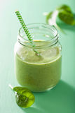 Healthy green smoothie with spinach mango banana in glass jar Stock Image