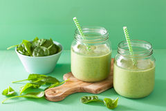 Healthy green smoothie with spinach mango banana in glass jars Royalty Free Stock Image