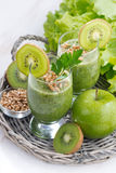 Healthy green smoothie with sprouts and ingredients, vertical Stock Photo