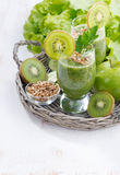 Healthy green smoothie with sprouts and white wooden background Stock Image
